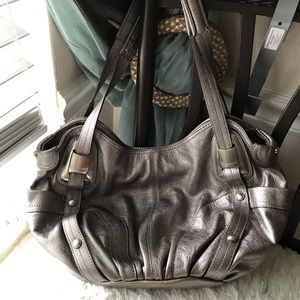 B. Makowsky Silver Metallic in color hobo bag